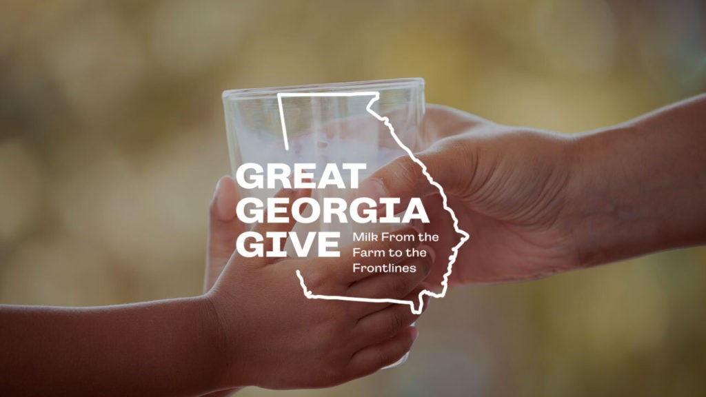 Great Georgia Give logo over image of two hands holding a glass of milk
