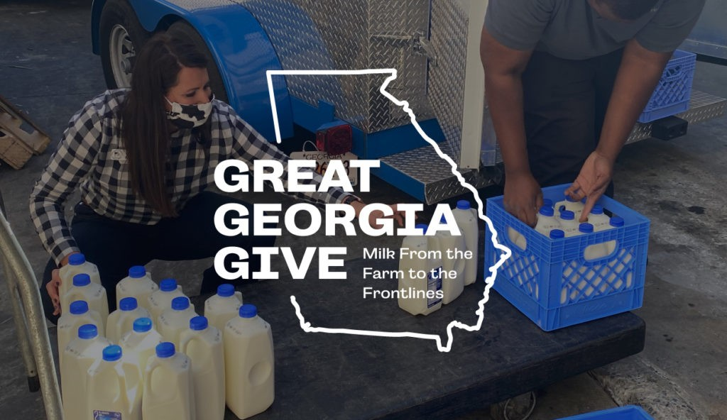 Great Georgia Give logo over two people putting half gallons of milk into crates